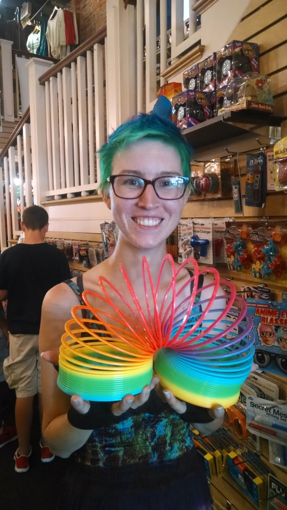 Rainbow hair with a rainbow slinkey at newbury comics
