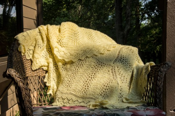 One yellow baby blanket, good for snuggles and keeping babies warm, of course.