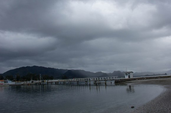 cloudy hazy bay at tairua new zealand