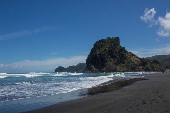 lion rock at piha beach new zealand