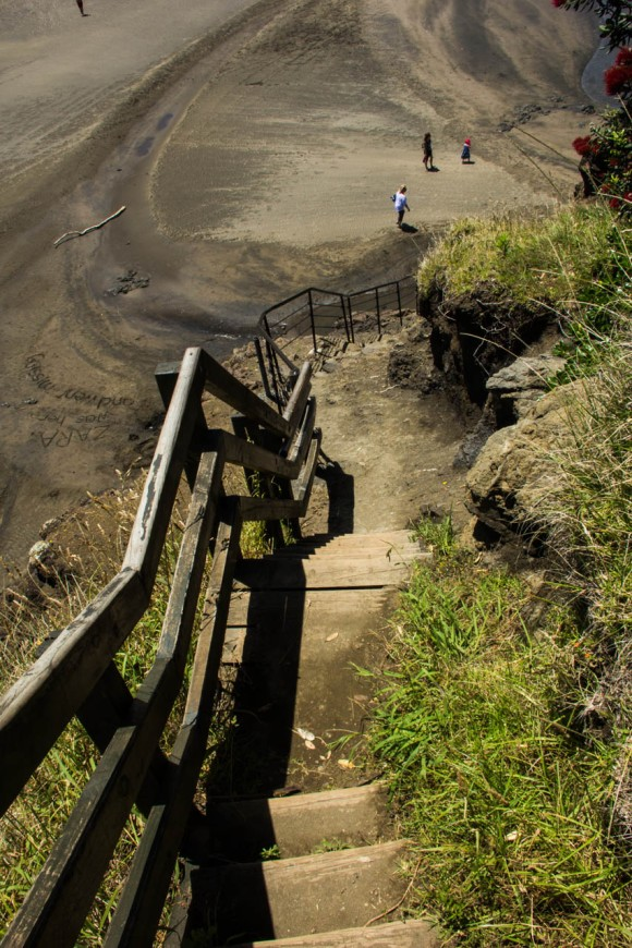 descent from lion rock at piha beach new zealand