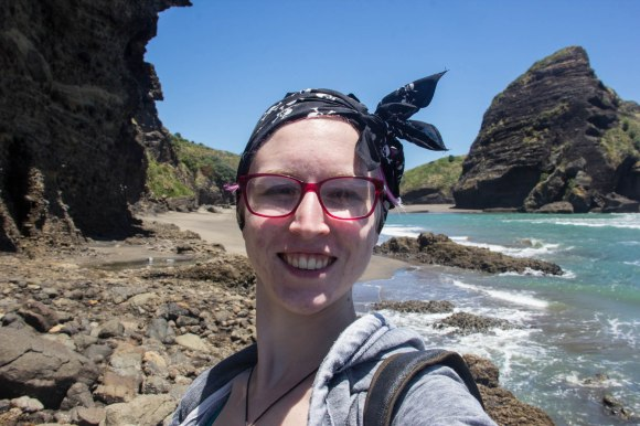 protect dyed hair from uv rays selfie at piha beach new zealand