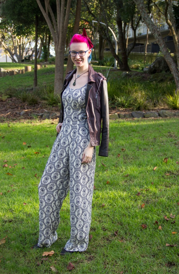 jumpsuit layered with jacket